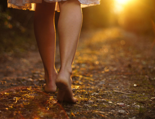 Young female legs walking towards the sunset on a dirt road ** Note: Slight graininess, best at smaller sizes